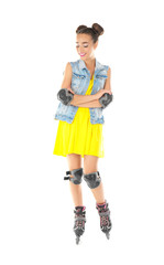 Beautiful young woman on roller skates against white background