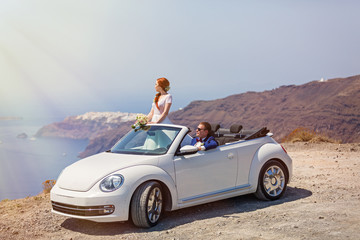 Wedding couple with the white car