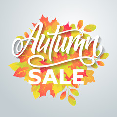 Autumn sale flyer on a background of leaves. Handmade vector lettering.