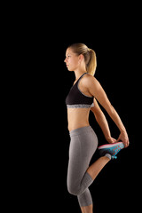 Woman doing stretching leg exercises..