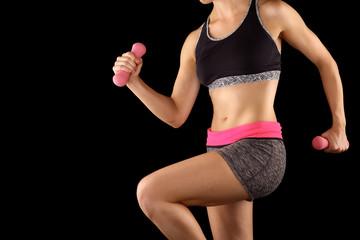 Woman lifting weights while doing aerobics.