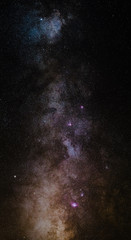 The outstanding beauty and clarity of the Milky Way, with details of its colorful core. Vertical panorama of 6 stitched photos. Telephoto captured high up from the Alps.