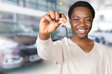 Young African American businessman holding a car key