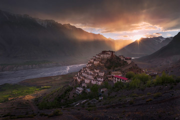 Tibetan Monastery in the Himalayas at sunset Wall mural