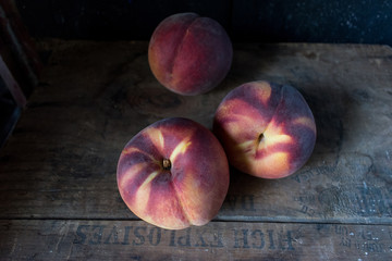 fall harvest of a group of ripe peaches