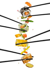 Sushi pieces placed between chopsticks, on white background