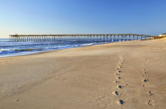 Fishing pier and sand at Kure Beach, North Carolina