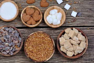Different kinds of sugar on table