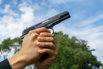 Shooting with a handgun