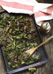 Kale chips with sea salt on baking tray