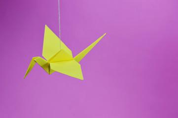yellow origami crane top view