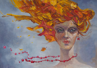Portrait of an artistic girl with autumn leaves in her hair