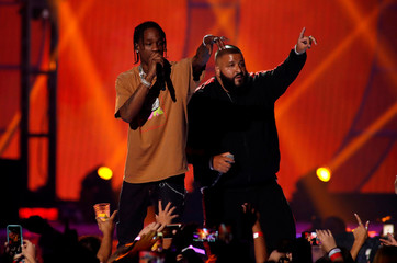 Travis Scott performs with DJ Khaled during the iHeartRadio Music Festival at T-Mobile Arena in Las Vegas