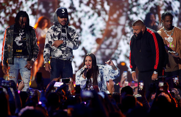 Demi Lovato performs with Quavo of the rap group Migos, Chance the Rapper, DJ Khaled and Travis Scott during the iHeartRadio Music Festival at T-Mobile Arena in Las Vegas