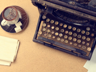 Vintage typewriter and a fresh Cup of coffee