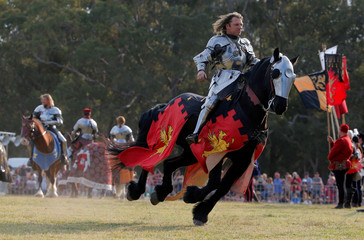 Australian jouster Phillip Leitch rides an introductory lap before winning the inaugural World Jousting Championship at the St Ives Medieval Faire in Sydney