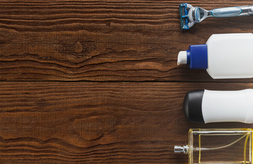 Mens care products, on a wooden background. Top view, is the place for the text