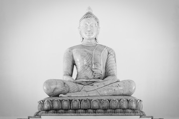 Marble buddha image on white background.Buddha statue in Buddhist  temple or wat, is public domain or treasure of Buddhism. (Shot at outdoor ,public area)