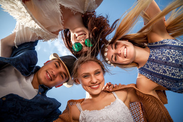 Group of friends in circle smiling and having fun