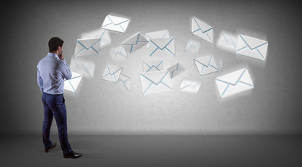 Businessman using email interface on a wall 3D rendering