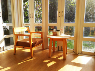 Table and chair in the coffee shop window see through the garden sunshine morning Feeling relax and comfortable
