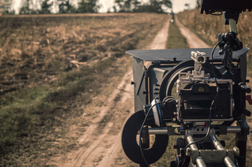 Compact professional mirrorless filming camera rig outdoors in production