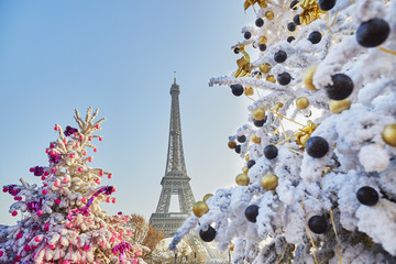 Christmas tree covered with snow near the Eiffel tower in Paris