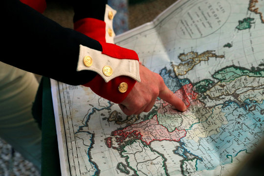 Mark Schneider who was born in Virginia in the United States and who impersonates Napoleon points on a map during the Napoleon Jubilee in Rueil Malmaison