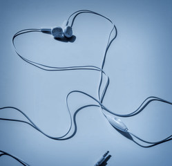 White headphones in heart shape