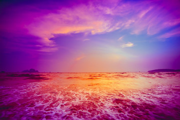 Foto op Aluminium Violet Beautiful tropical sunset in Krabi, Thailand. Dramatic and picturesque evening scene. Ocean waves and colorful cloudy sky in the background. Nature landscape. Travel background. Bright purple toning
