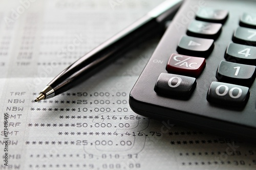 Business, Finance, Savings, Accounting Or Loan Concept : Calculator And Pen  On Saving