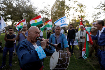 Israelis from Kurdish origin take part in a rally in support of the Kurdish referendum outside the American consulate in Jerusalem