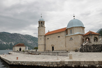 Arrival to the famous Our lady of the reef Island and Church in Kotor Bay of Montenegro