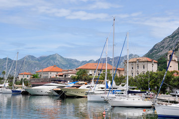City embankment with sailboats in the city of Kotor in Montenegro