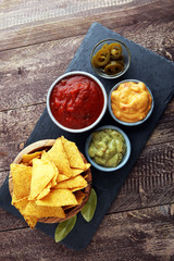 Nachos Tortilla Chips and jalapeños Chili Peppers or Mexican ch
