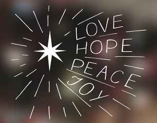 Hand lettering Love, hope, peace, joy with star.