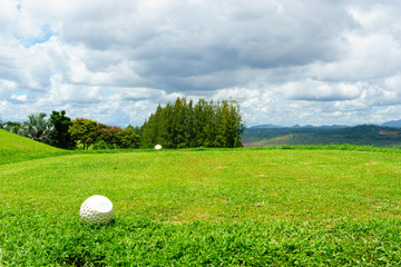 tee off with forest and blue sky and cloud background.