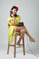 Beautiful  woman speaking via vintage phone.
