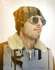 Double exposure portrait of a trendy man with a deer winter scene