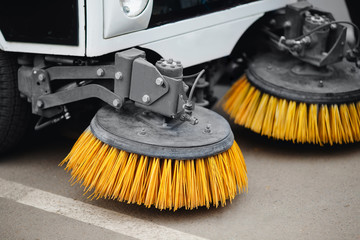Close-up street sweeper machine cleaning the streets. Concept clean streets from debris.