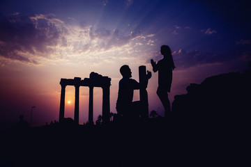 Silhouette of lover backdrop of ancient ruins.