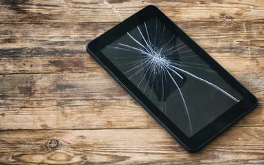 broken tablet computer, cracked glass display