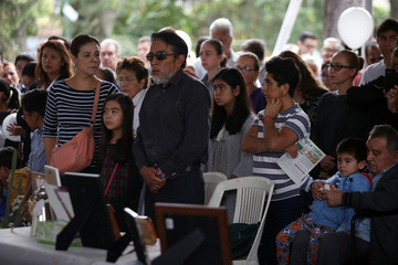 Family members and friends of children and grown-ups who died after their school collapsed in an earthquake, attend a mass, in Mexico City