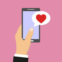 phone in hand with sms message heart