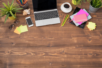 Wooden office table with tecnology and office supplies