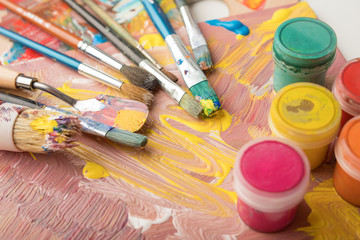 Paint brushes and color containers