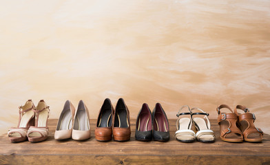 Organized woman's shoes on wooden floor Wall mural