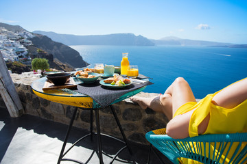 Woman enjoying breakfast on terrace