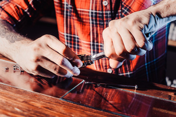 The process of servicing the mechanical vape device. Master replace wire for smoking. Ecig rapairing process.
