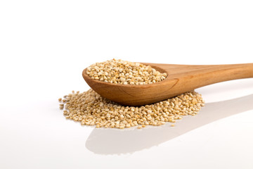 Pile of grain quinoa seeds in spoon